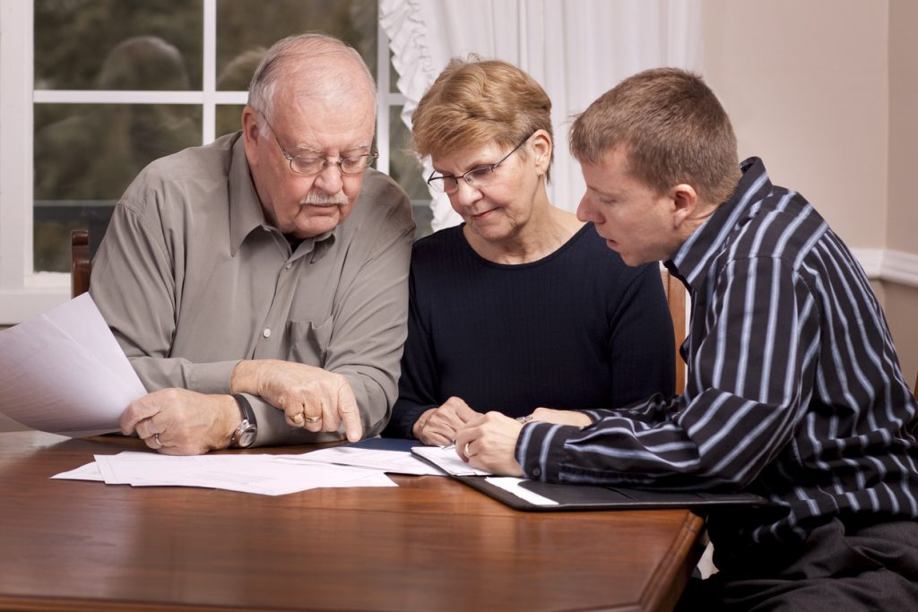 Parents and Adult Son Preparing a Will